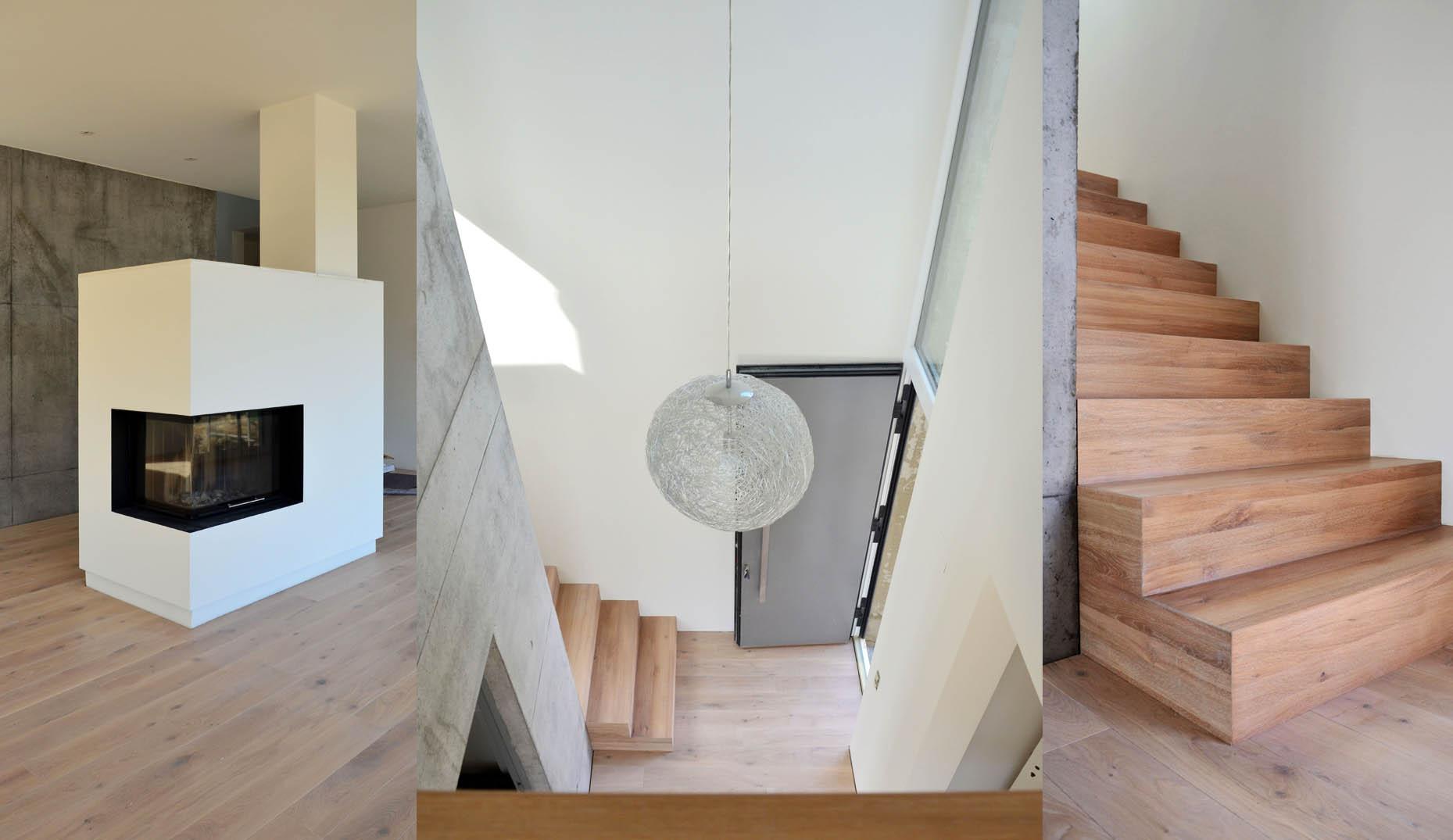 Ein moderner Wohnraum mit Holztreppe und Betonwänden