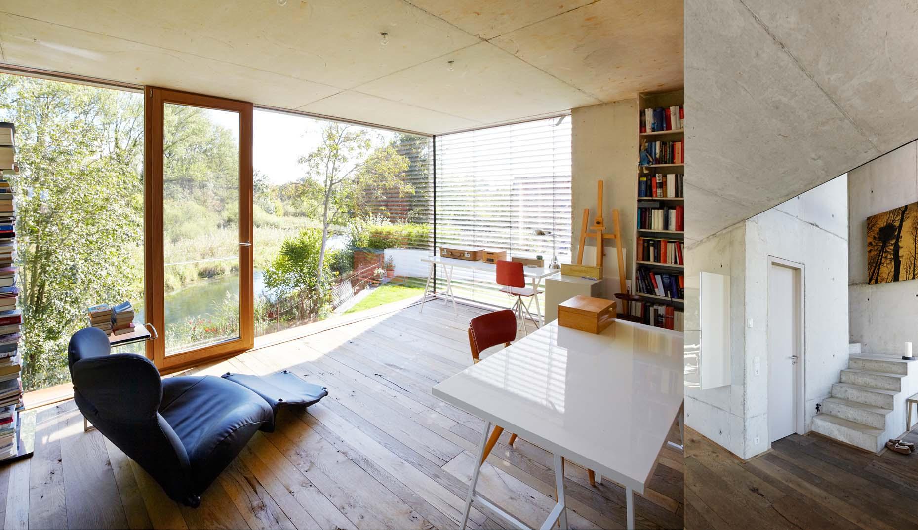 Ein Innenraum mit Betonelementen und einem Echtholzboden in Frankreich