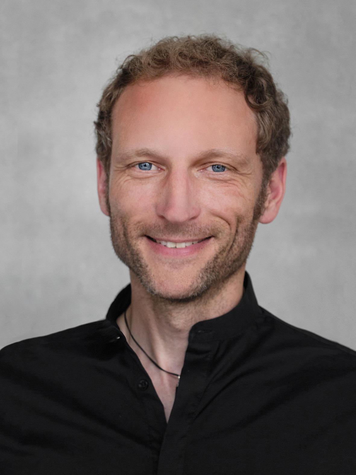 Ein Bild von Mike Schneider, Gründer von Sennrich und Schneider